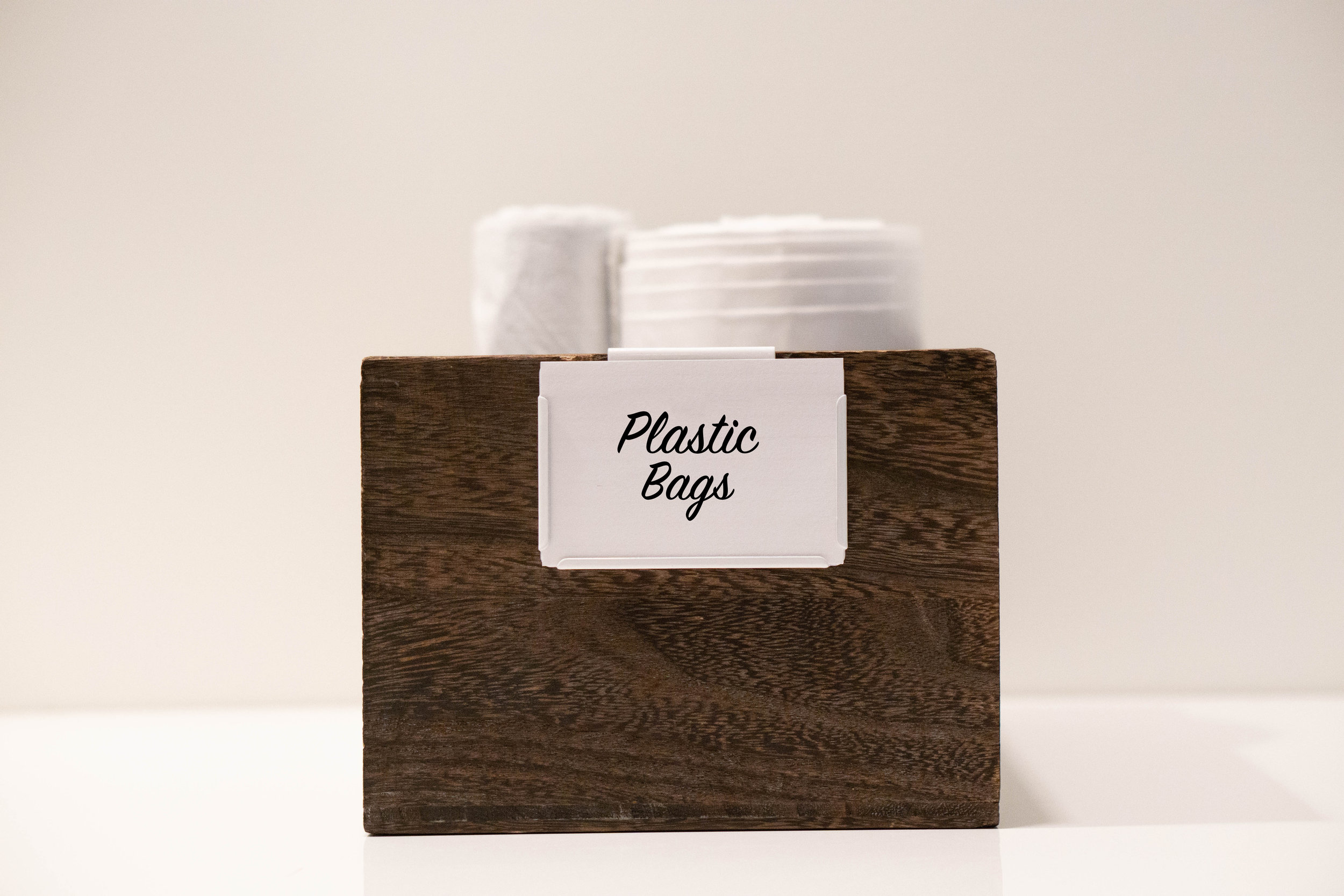 "Tip #3: Label, label, label! We live by the motto ""A place for everything, everything in it's place."" Adding labels ensures items will make it back to their place. For certain areas storage needs are ever changing. Using bin clips like the one above allow you to easily switch out the insert as the contents of the container change. This style can be found at The Container Store and comes in a variety of colors."