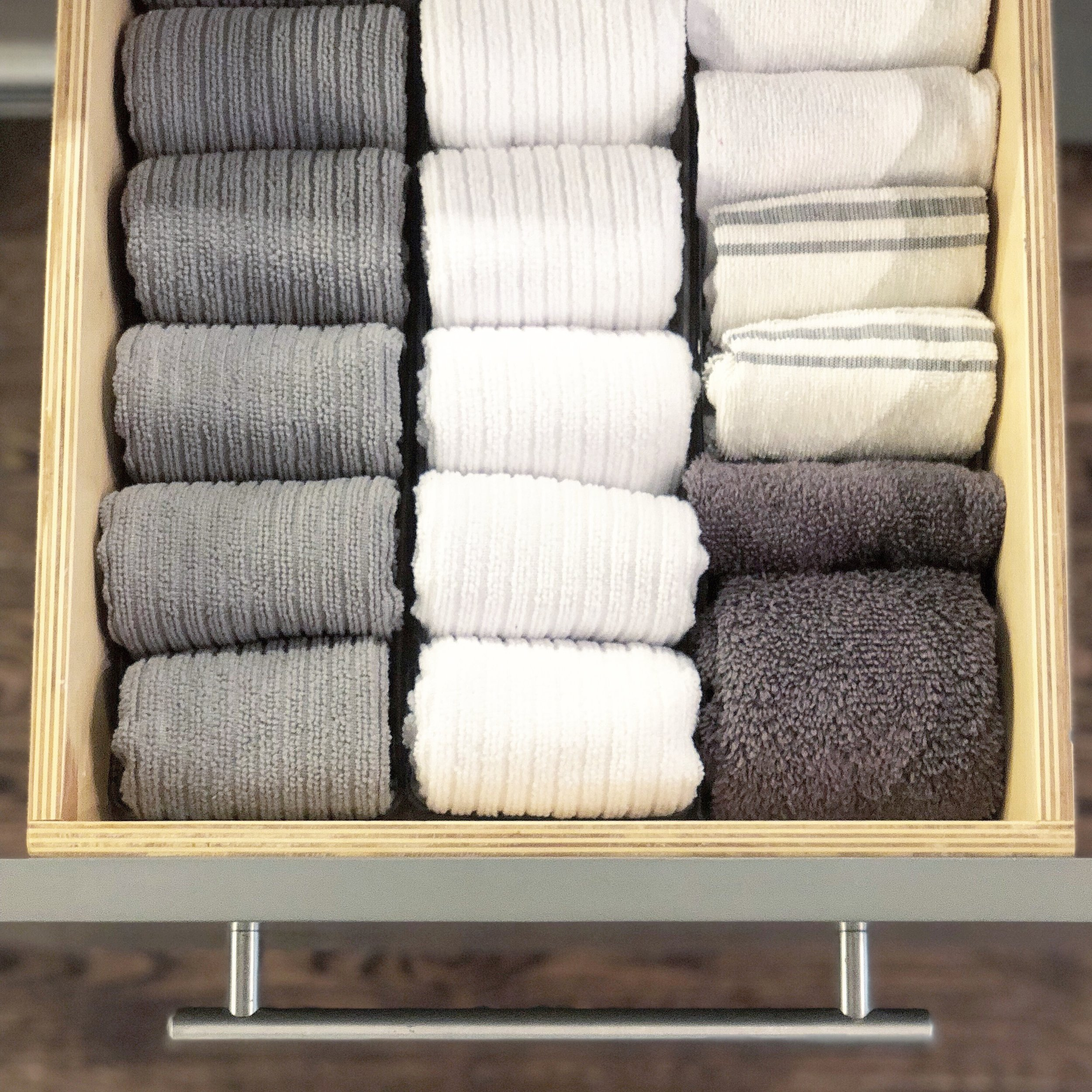 Tip #4: File folding. Transform your drawers by file folding your items, also known as the KonMari method. This folding style works everywhere in the home from your dish towels to your denim. Instead of stacking items and not being able to see everything, file folding allows you to see it all at once!  We hope you've enjoyed these tips! - The OC CO. Team