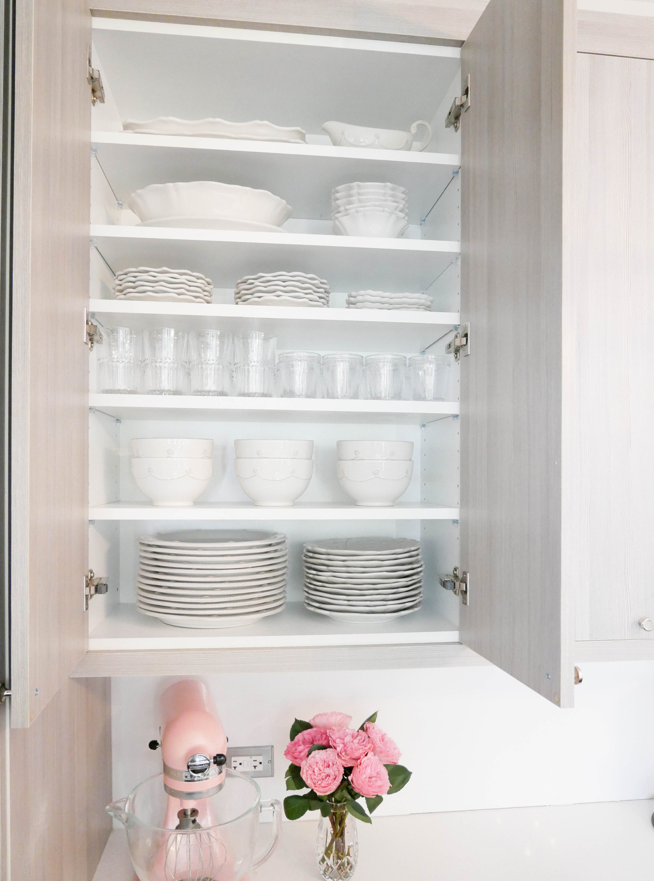 In order to maximize the vertical space in the cabinets, we added additional shelves to display Caitlin's beautiful dishware. Your local Home Depot sells these shelves and brackets, and will cut the shelves to your measurements.