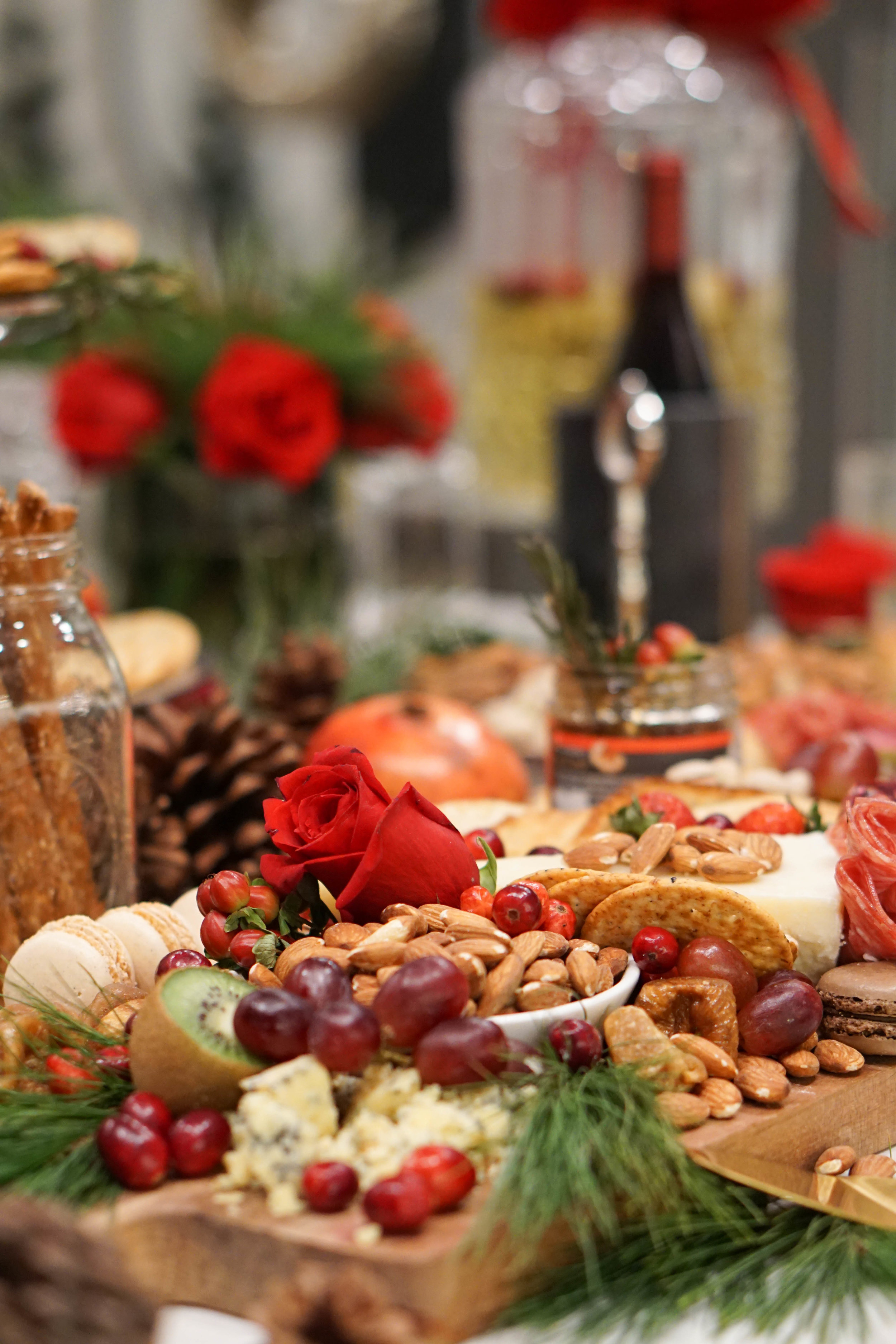 If you are thinking of hosting your own Holiday party next year, here are a few pointers:  -Get ready as much as you can before the day of the party. Laundry, house cleaning, and grocery shopping can all be done in advance to ensure that the day of is reserved for the finer details.  -Consider any special diets, if you have friends with food intolerances or restrictions be sure to have a small section just for them. Its a thoughtful consideration that makes the night feel personal to those guests.  -Add layers. For my set up I layered in greenery, florals, cranberries, and pinecones. These touches create a visual cohesiveness throughout the spread.  -Save plenty of time to get yourself ready. If you allow a few hours to relax and get dressed before the start of the party, you will be collected and prepared to greet guests as they arrive.  -You've worked hard to bring everything together. Take time to enjoy the night and each guest.