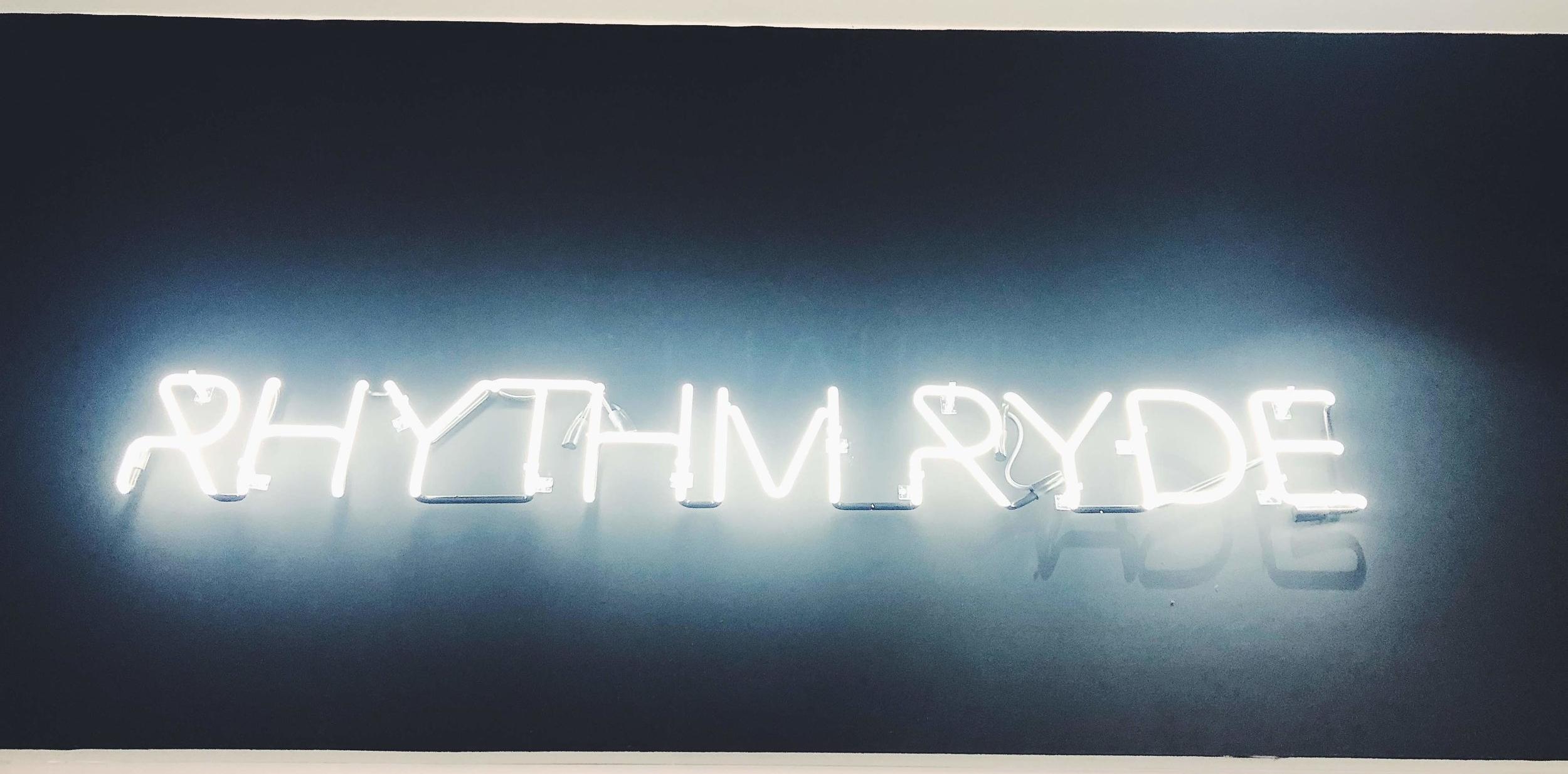 Rhythm Ryde neon sign in dumbo.