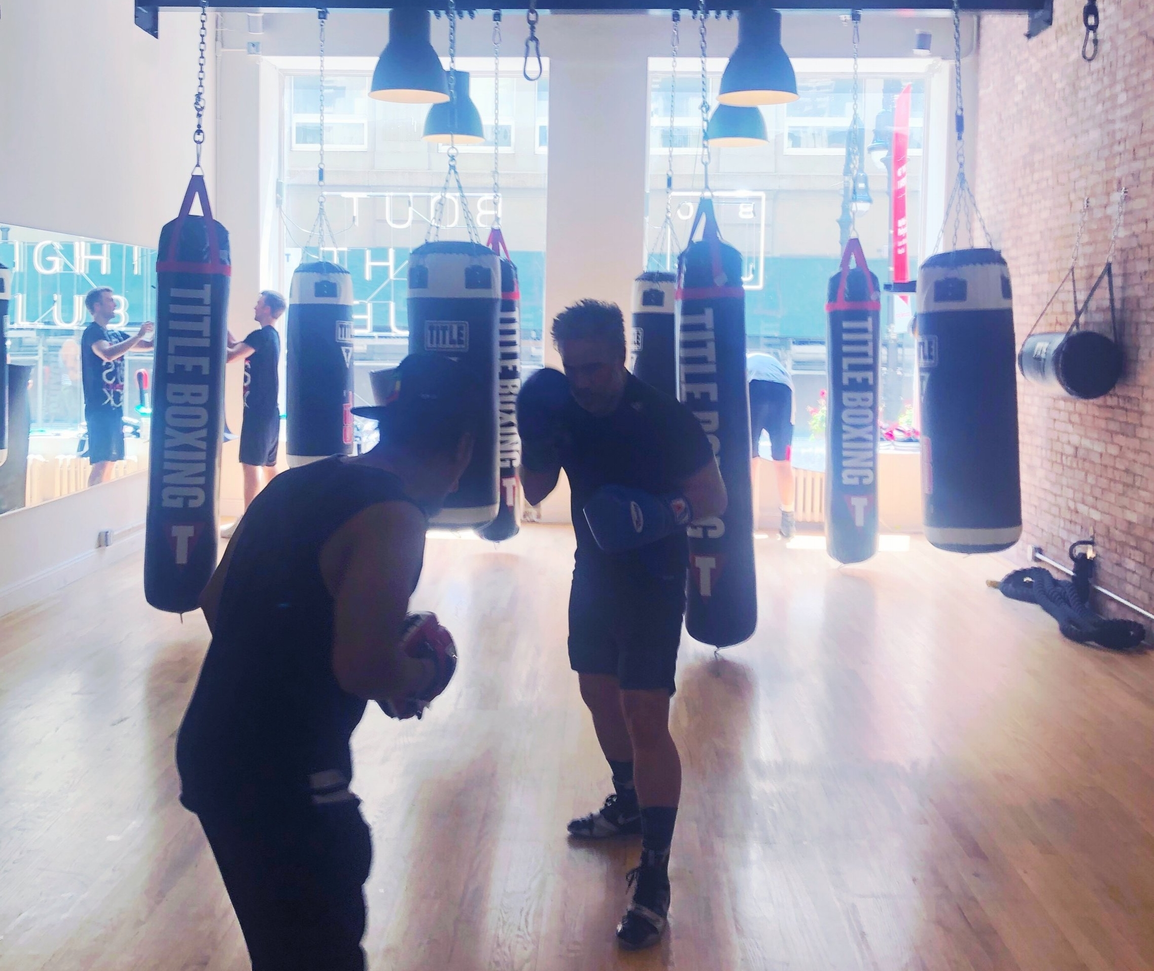 Two men boxing at Bout Fight Club in FiDi.