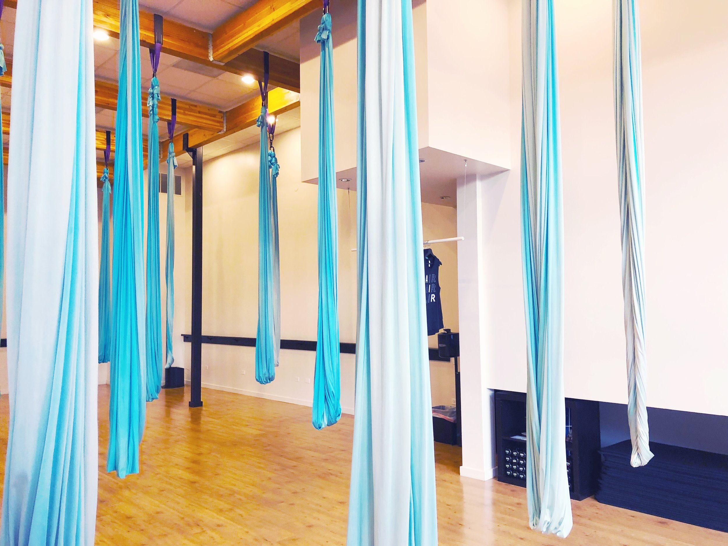 Aerial hammocks at AIR fitness class in Chicago.