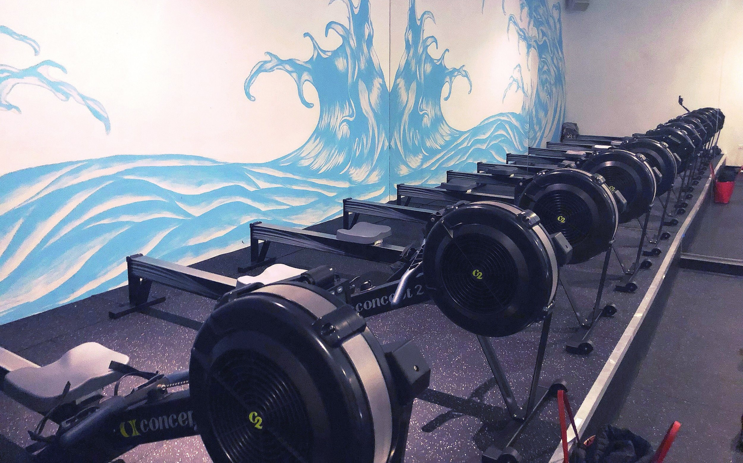 Inside Iron and Oar studio with rowers in Chicago.