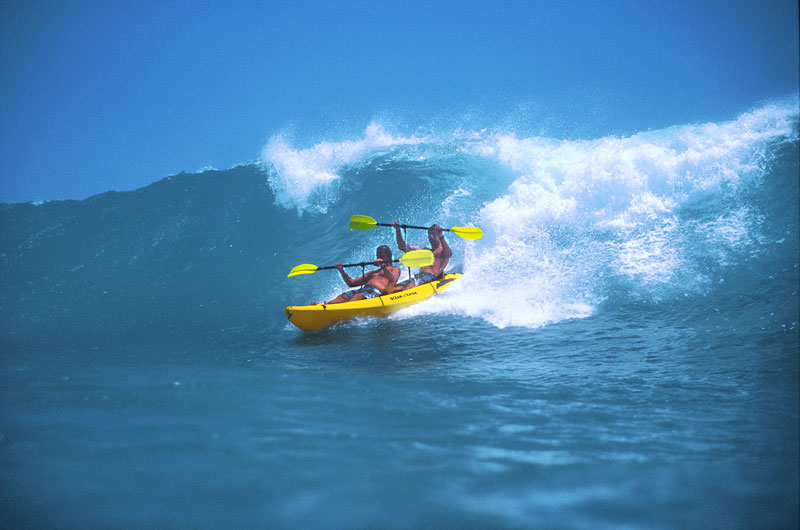 Big surf on Oahu's south shore near waikiki - kayak surfing