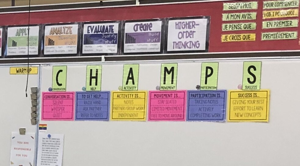 CHAMPS classroom management strategy. The teacher simply moves the round magnet to the expectation.