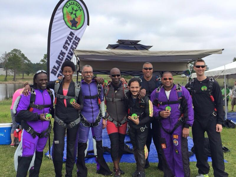Lindsey (3rd from left) poses for a photo with other Team Blackstar skydivers during the 2nd Annual Team Blackstar Record Jump in Fitzgerald, Georgia.  Photo credit: Danielle Williams