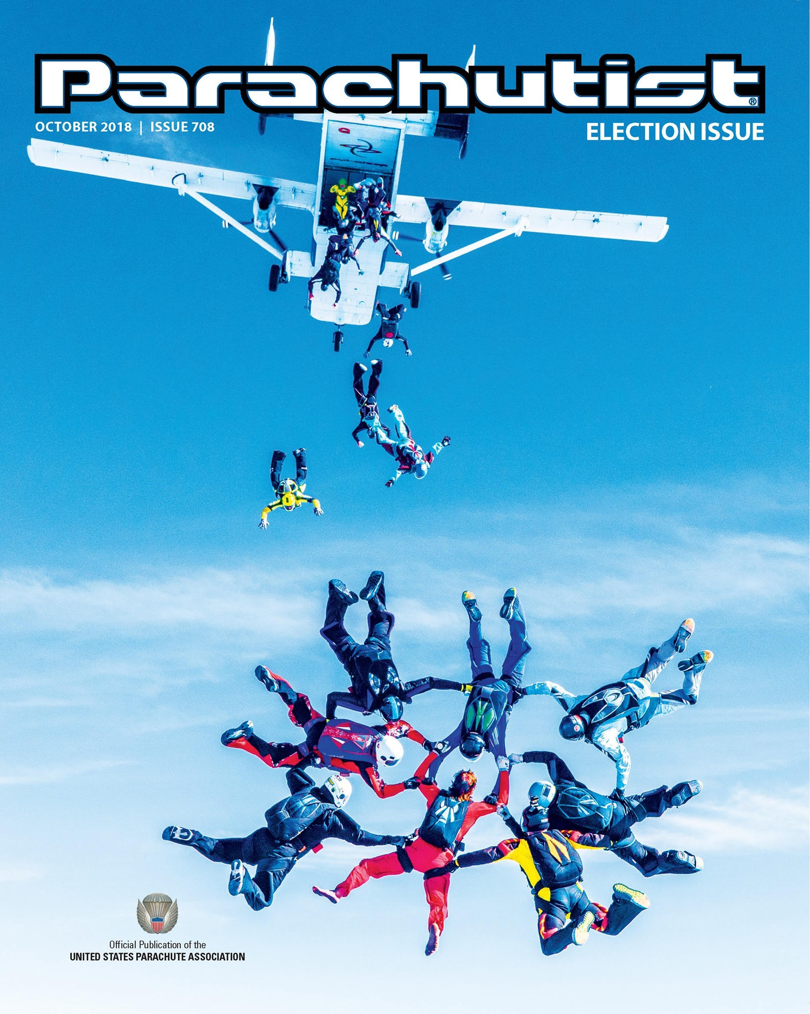 """Michael (bottom left) is holding the left leg strap of """"Barefoot Roger"""" Ponce on the 708th Issue of the Parachutist Magazine.  Photo credit: Norman Kent."""