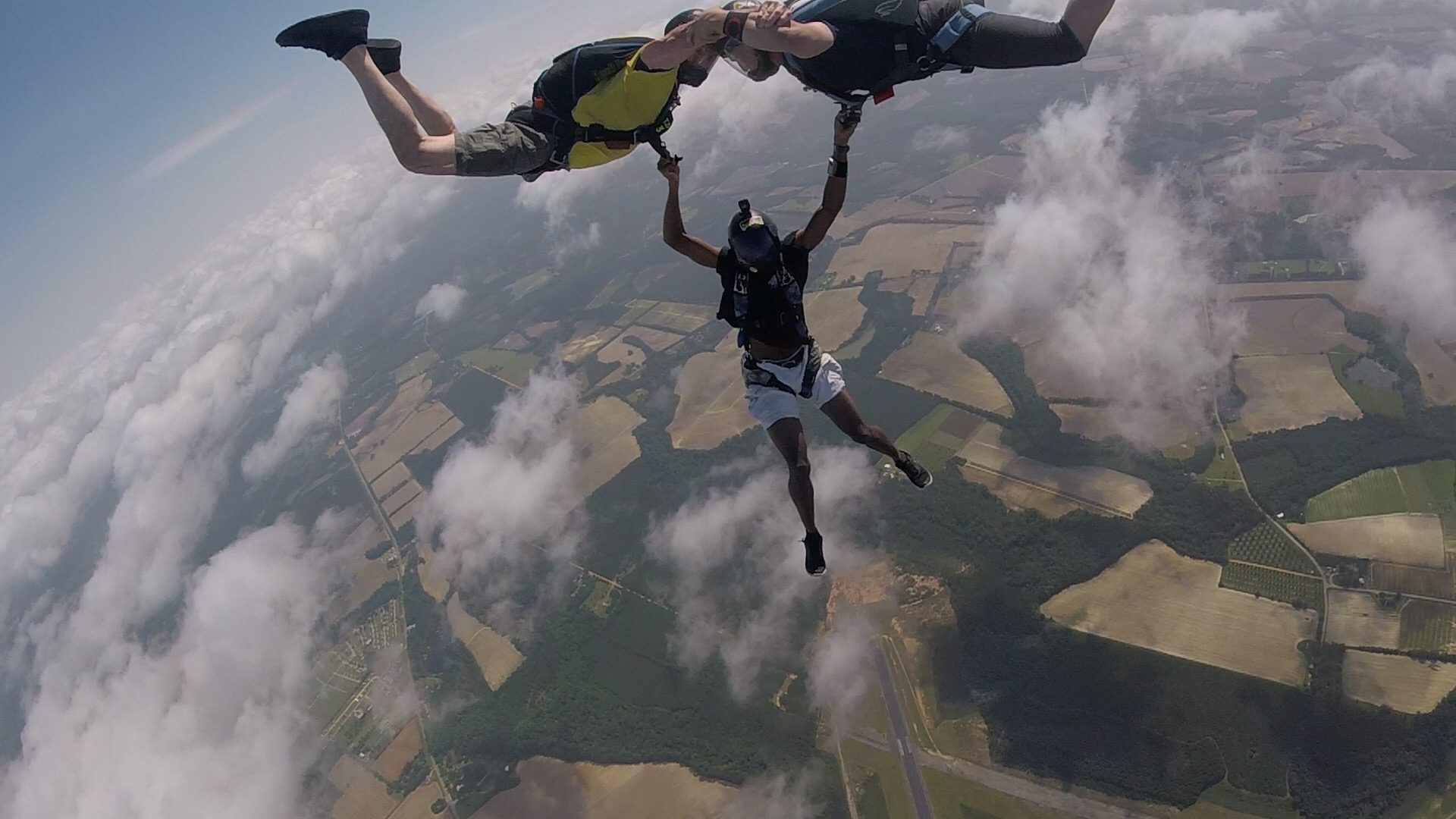 Photo of William Middlebrook participating in a three way hybrid skydive.