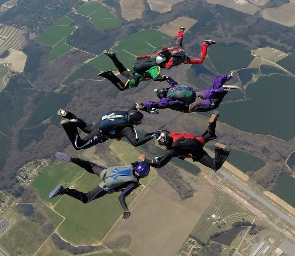 Sean Sylvester (3rd from the bottom) along with the other five founding members of Team Blackstar skydivers during the 1st Annual Team Blackstar Record Jump in Fitzgerald, Georgia.  Photo credit: Dennis Trisch