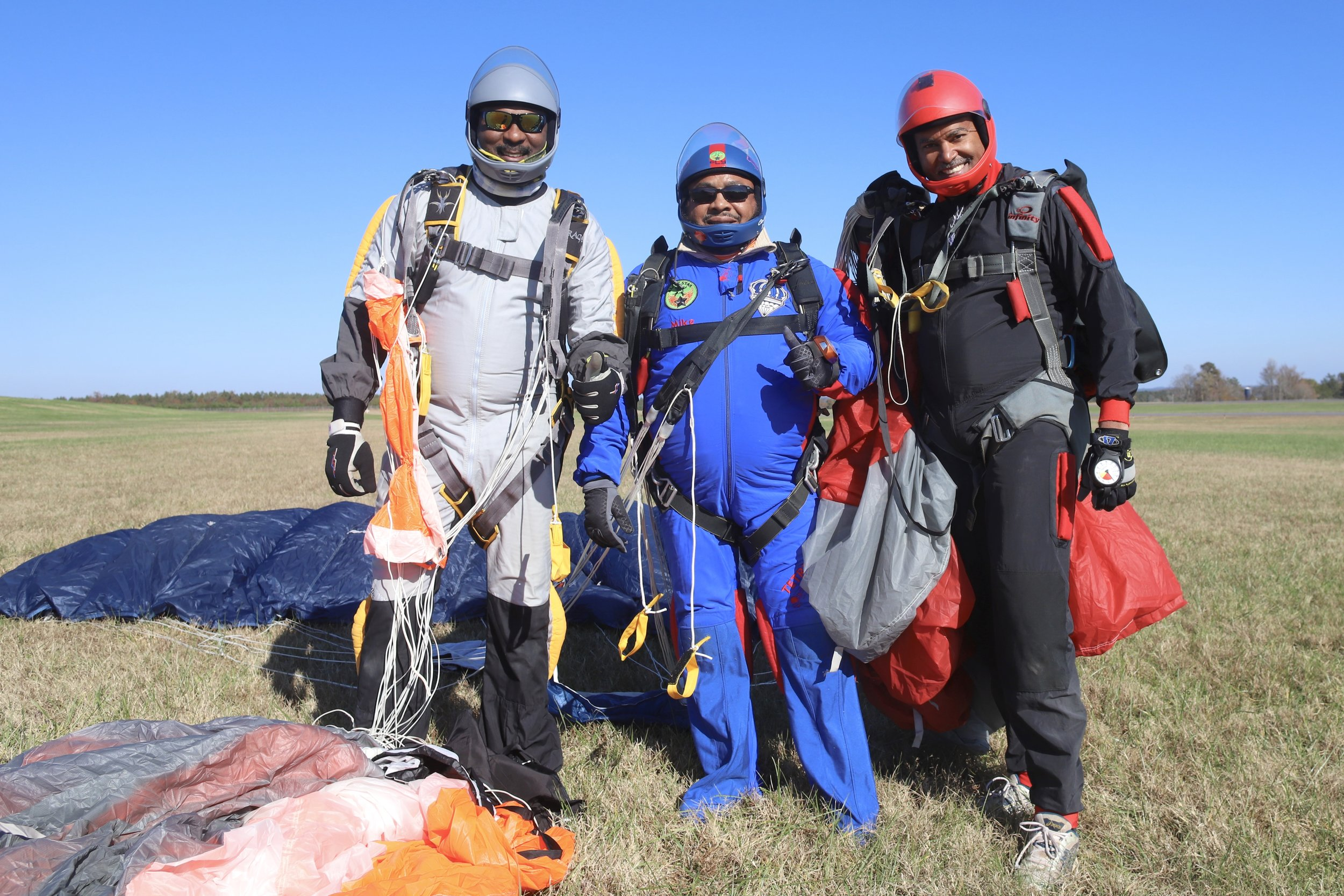 Mike (center) poses for a photo with Ken. H and Leroy J. after a successful skydive in North Carolina.  Photo courtesy of Don Carrington
