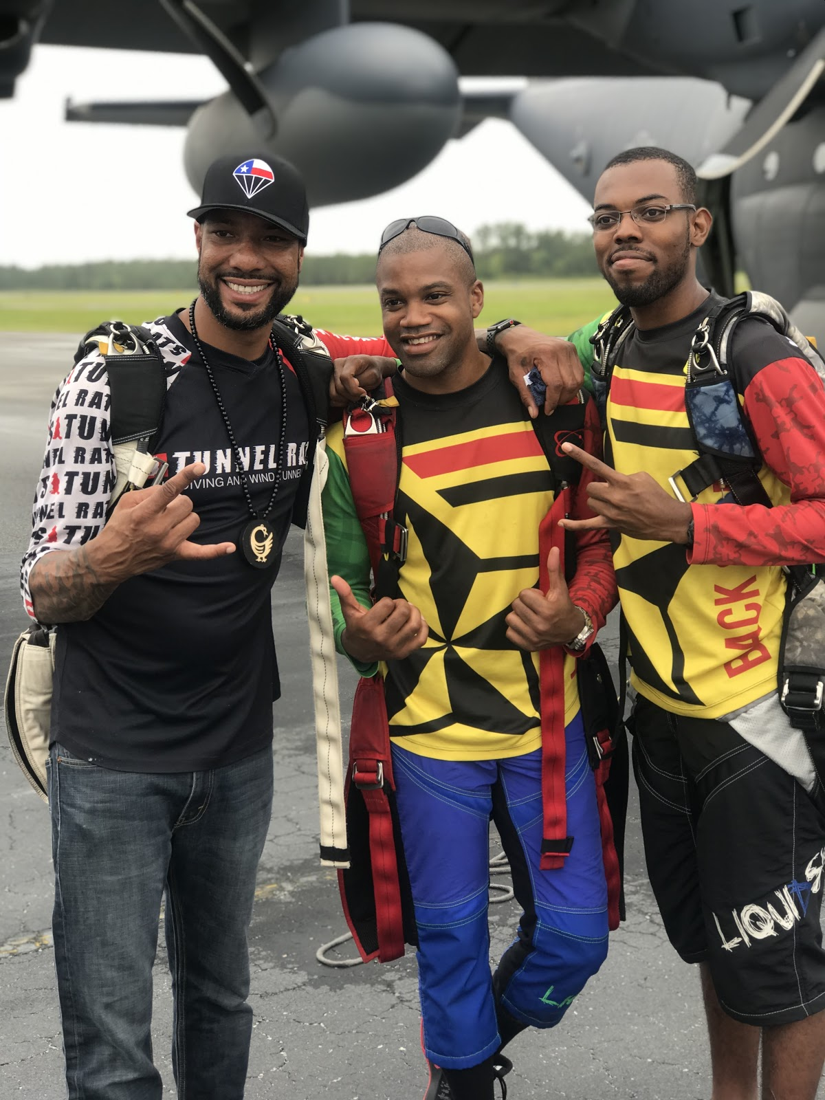 Skydivers  Waz Choudhry ,  Nicholas Walker  and  Will Middlebrooks  flash shaka signs at the camera during the Legacy Flight Academy  Eyes Above the Horizon  flight camp in Valdosta, GA.  Photo courtesy of Danielle Williams.
