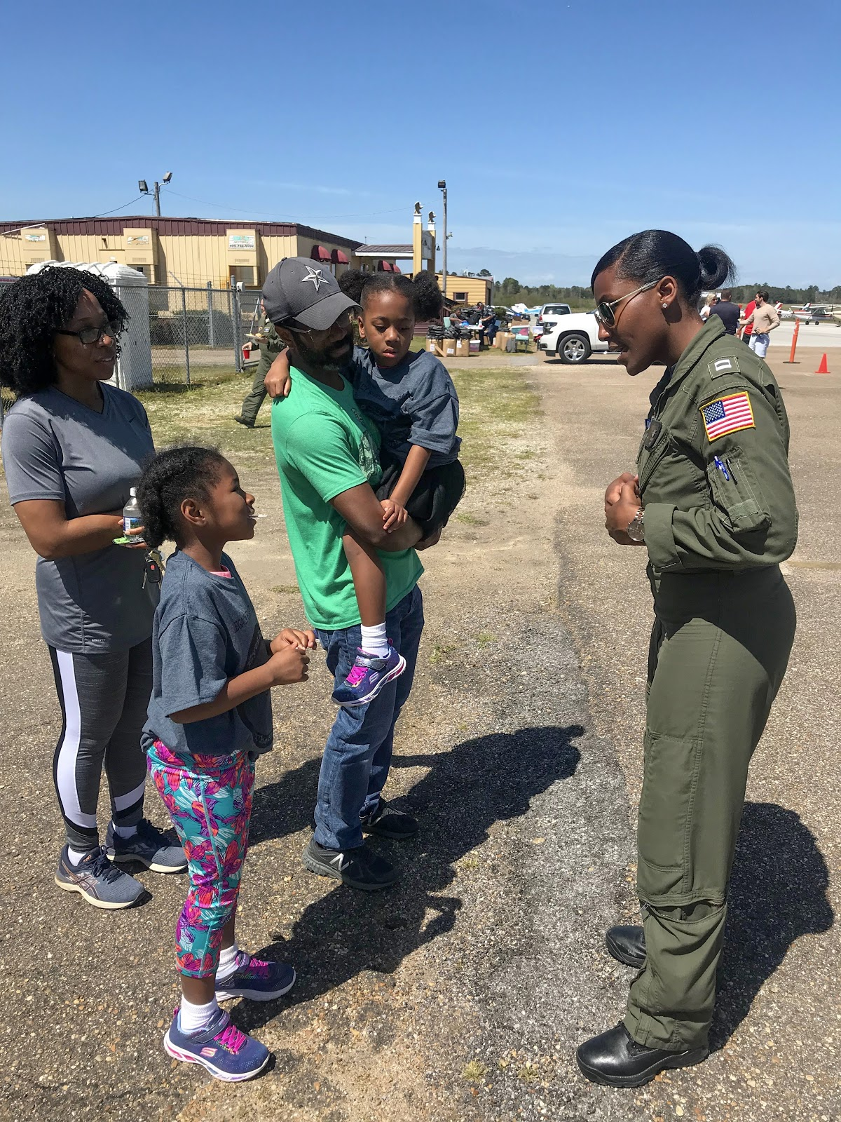 Coast Guard pilot Angel Hughes invites a participant to visit her airplane during a youth flight camp in Tuskegee, AL.  Photo courtesy of Danielle Williams