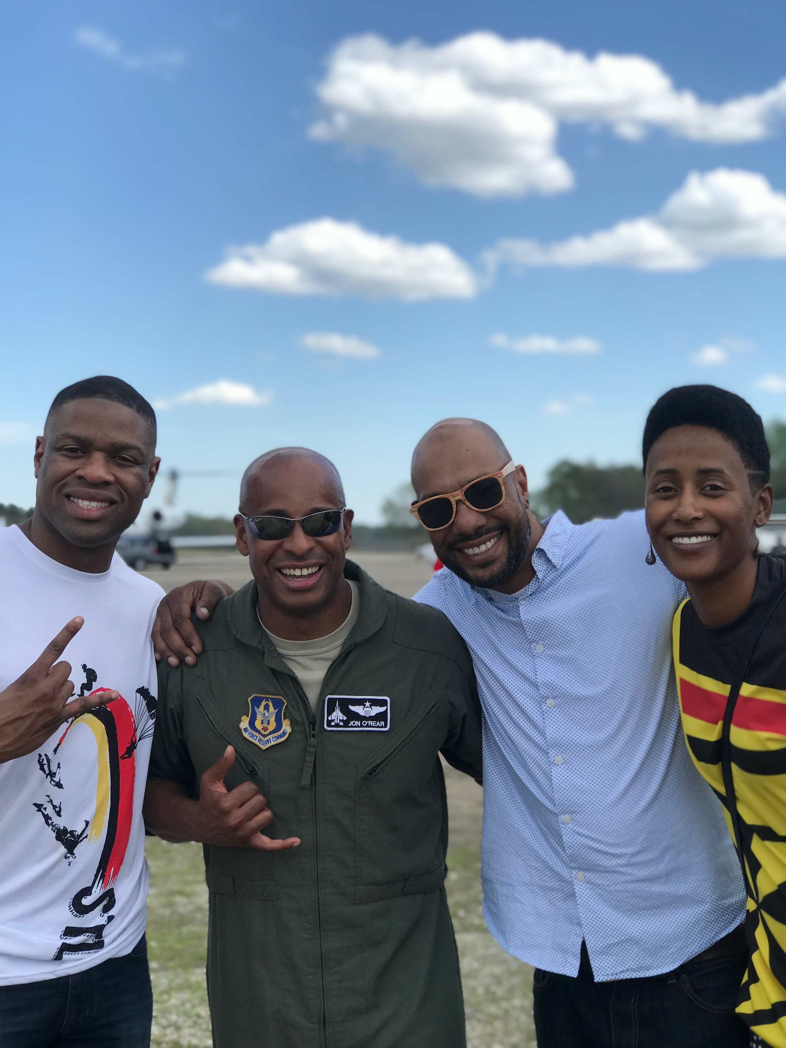 Emanuel Brice, Lieutenant Jonathan O'Rear, Waz Choudhry and Danielle Williams pose for a photo at Moton Field in Tuskegee, AL.