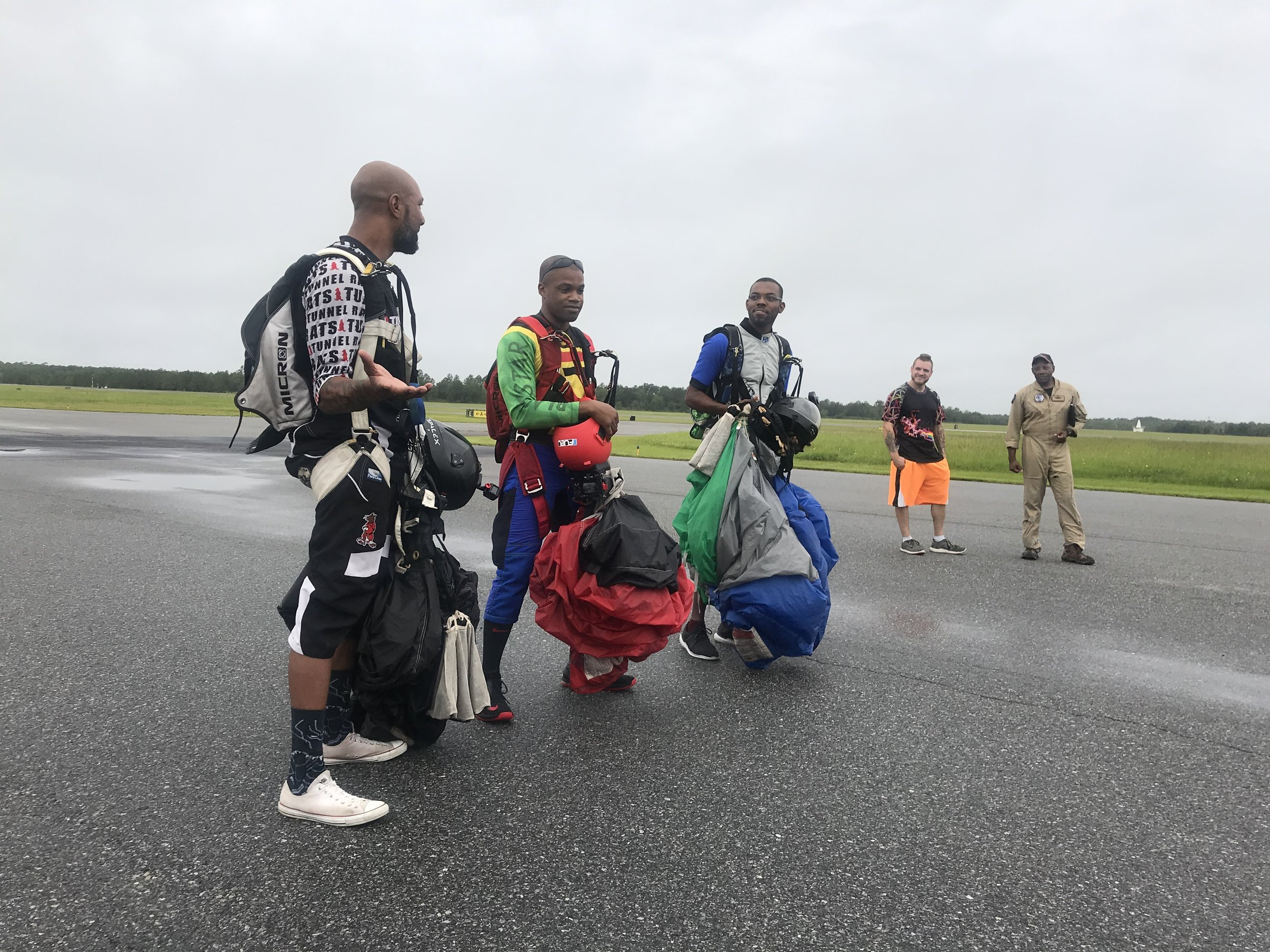 After a successful landing the skydivers briefly answered questions on the ramp.  Photo courtesy of Danielle Williams