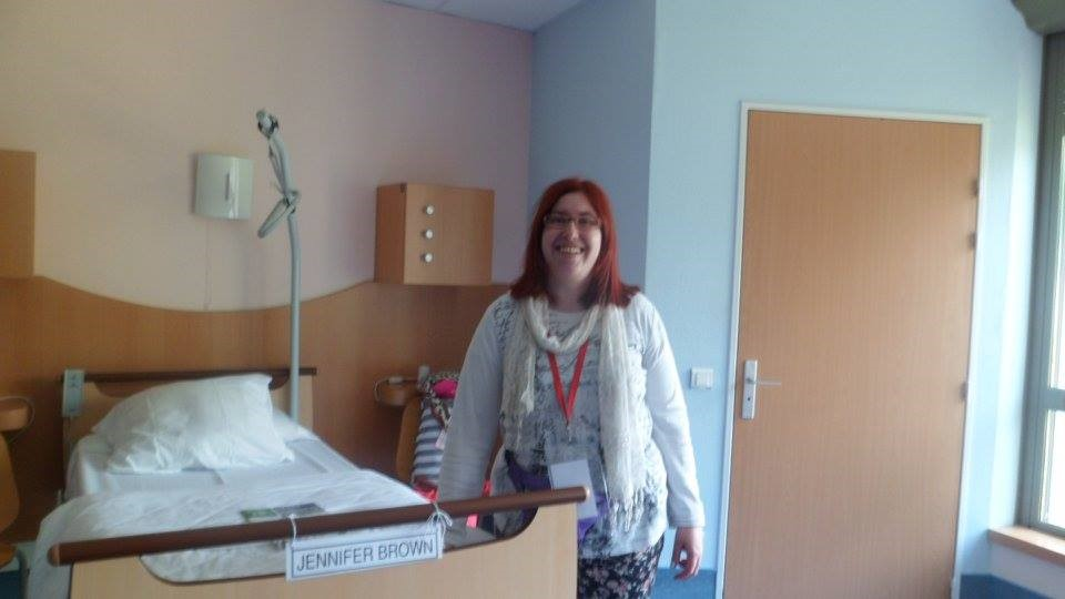 Me by my hospital bed. We stayed on wards. I'm smiling in this picture - but it was before I realised my bed actually had my name stuck on it!