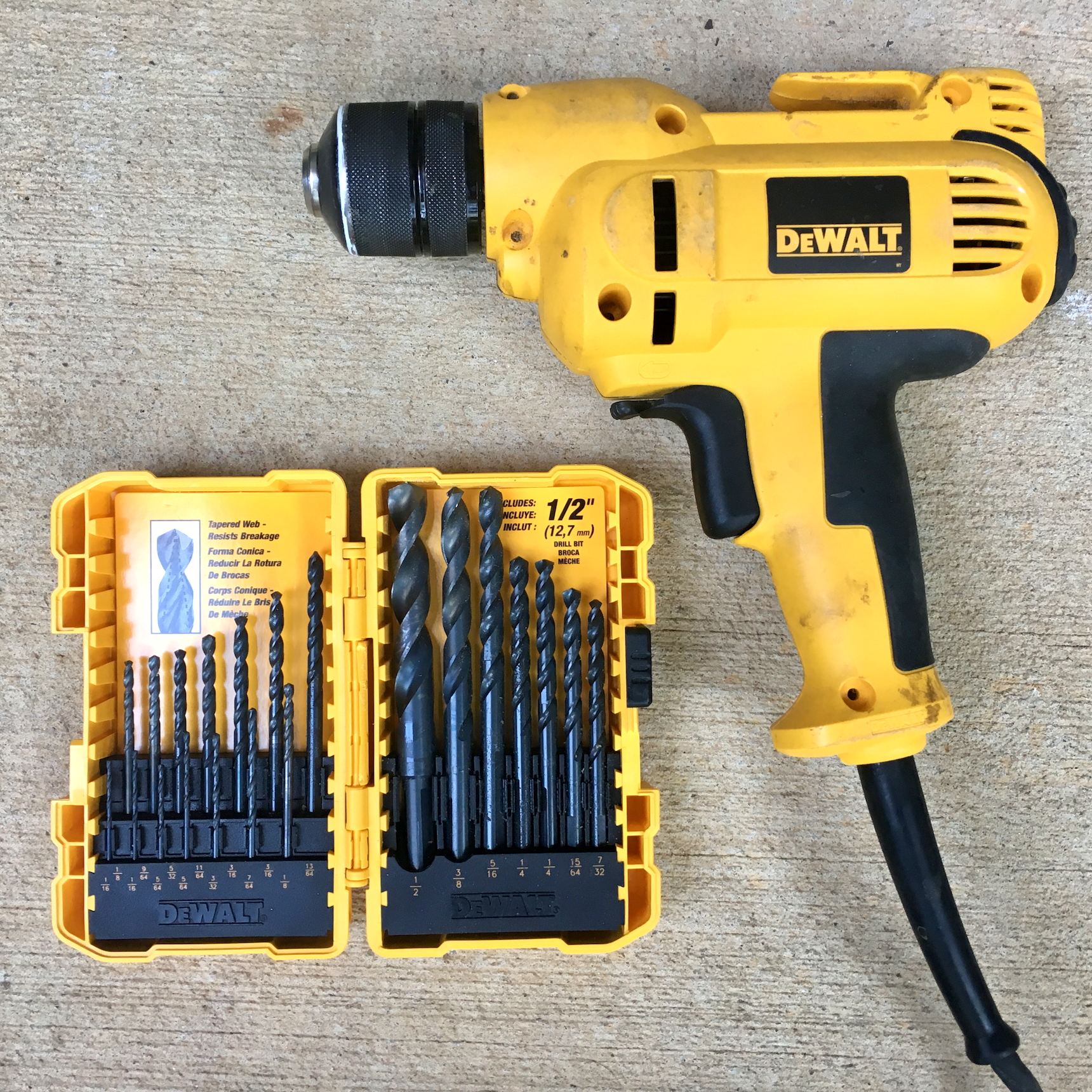 Justin's drill and a set of bits. Bits should be considered expendable. They break, get dull, and get lost, so don't spend a fortune on top-quality bits unless you really need them.