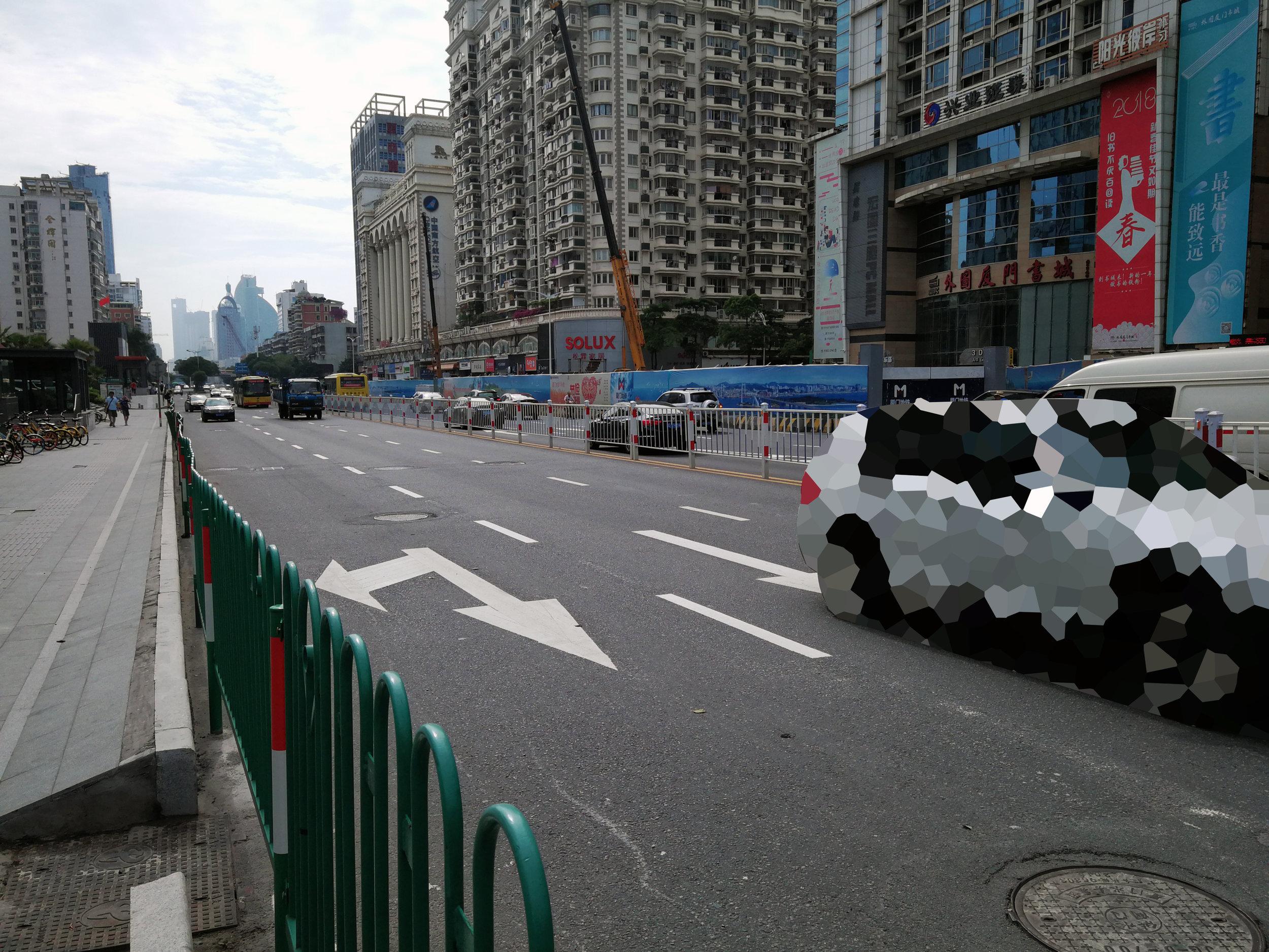 car on street pixalated.jpg
