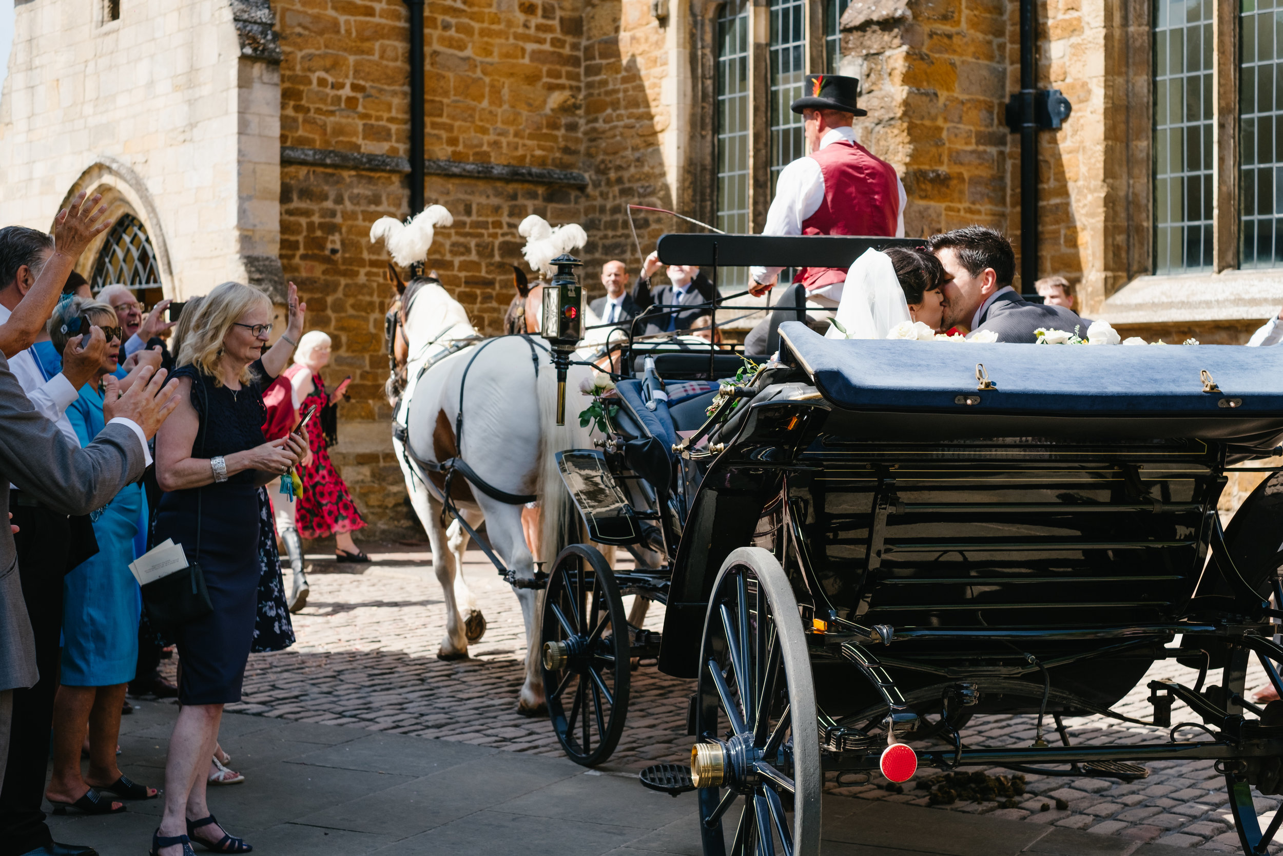 bride-and-groom-in-horse-and-carriage.jpg