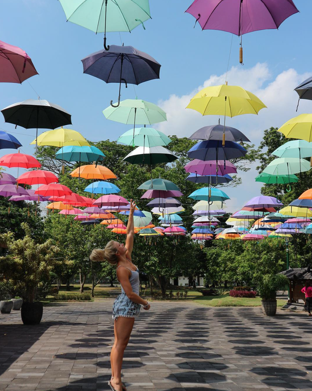 Reaching for the stars (umbrella).  Prambanan Temple