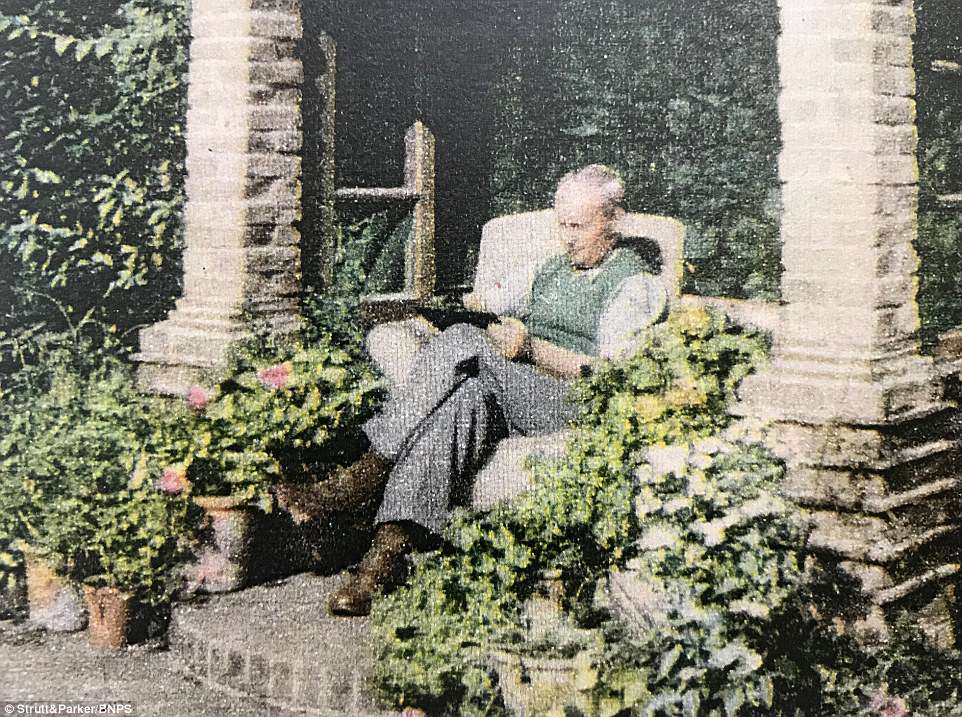 The true gardener, like an artist, is never satisfied - Pictured, H.E. Bates relaxes outside his house