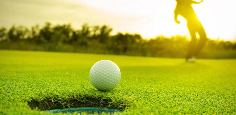 Golfer Putting Golf Ball