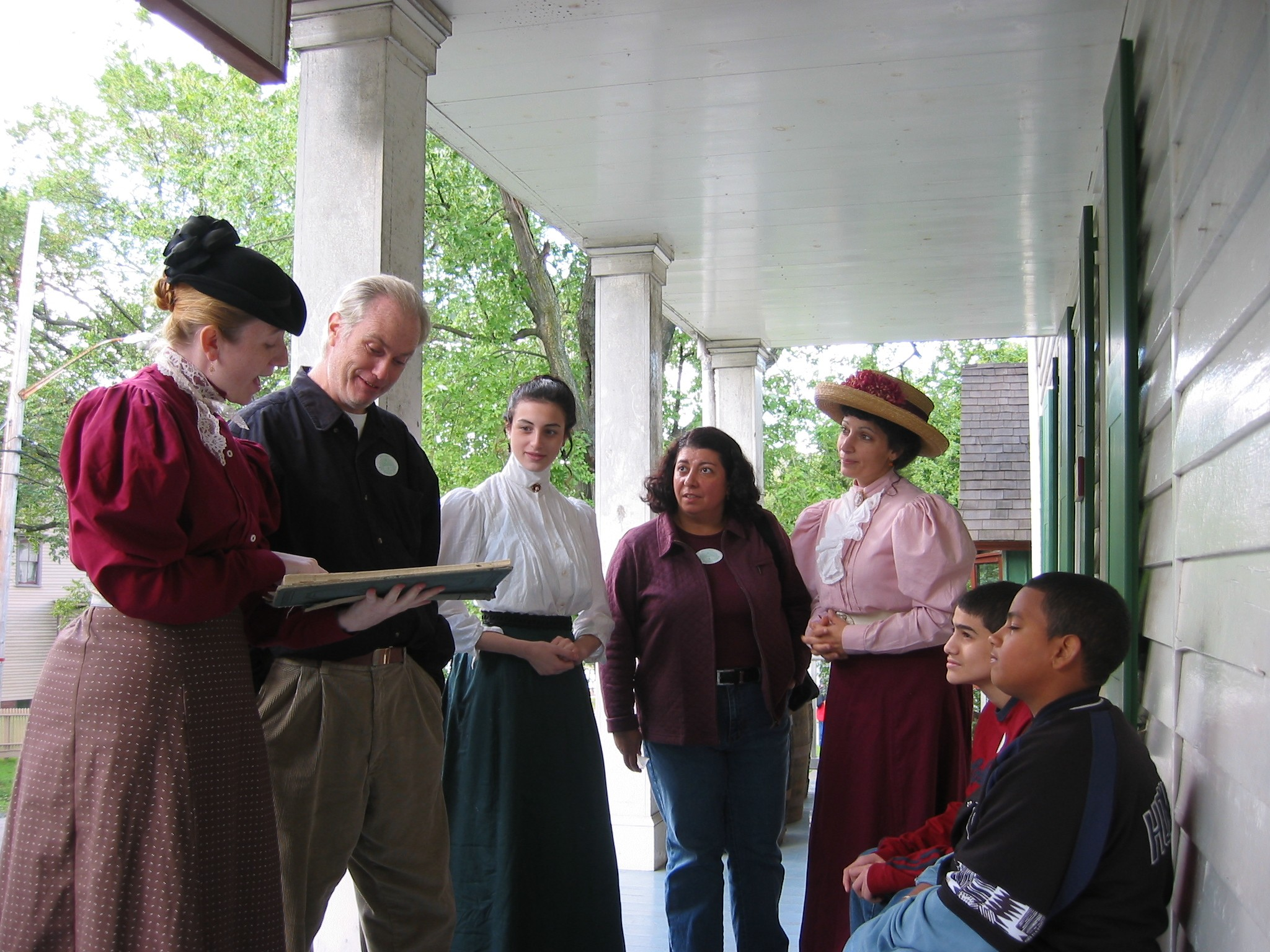 Black Sisters on Store Porch with Famly.jpg