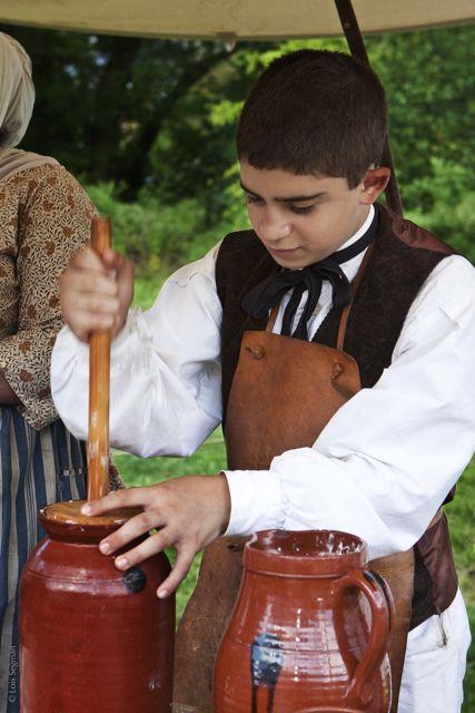 RC Fair © Lois Segman 2009-09-13_403351 boy churning butter.jpg