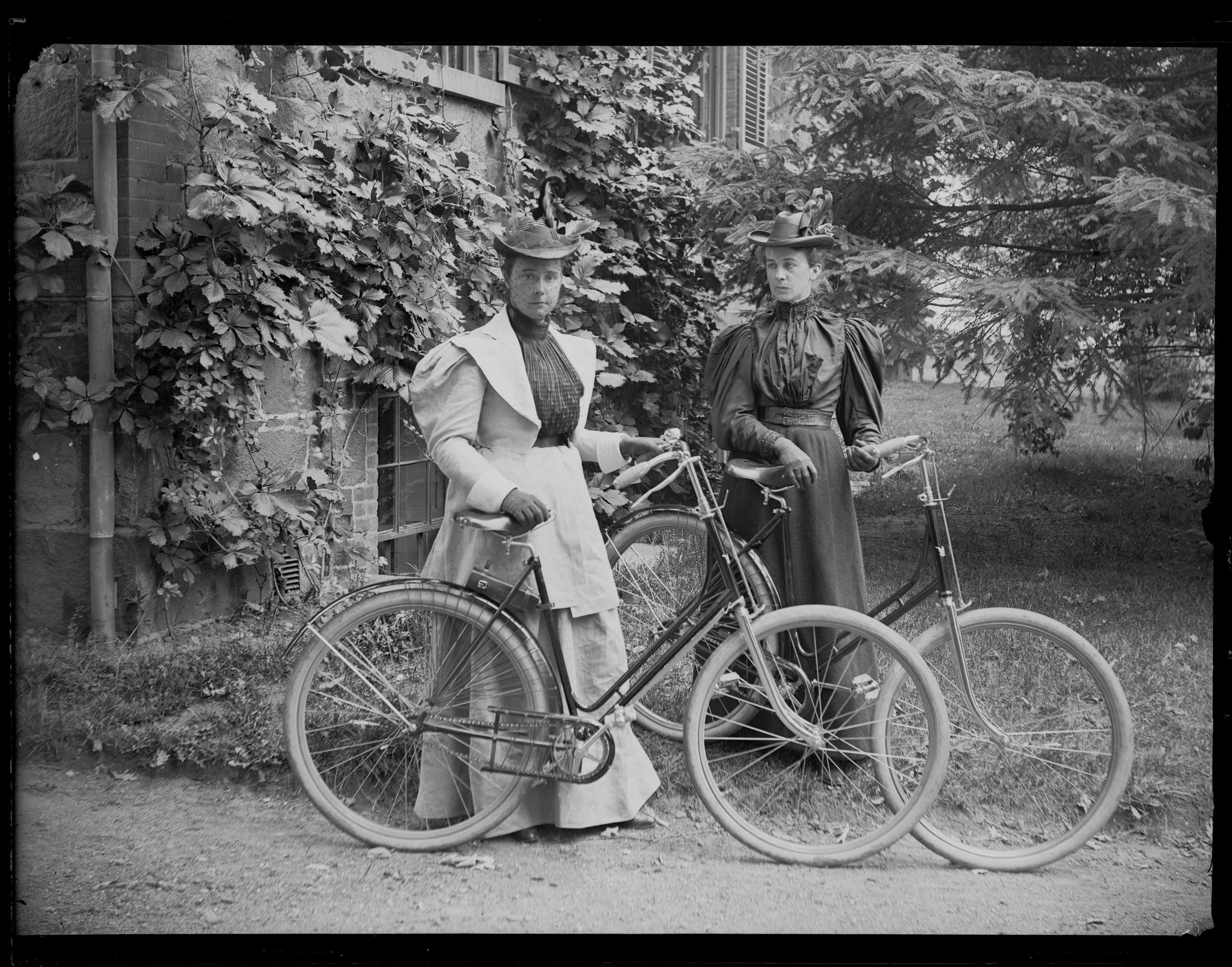 Violet Ward and Daisy Elliott with bicycles, Staten Island, ca. 1895.