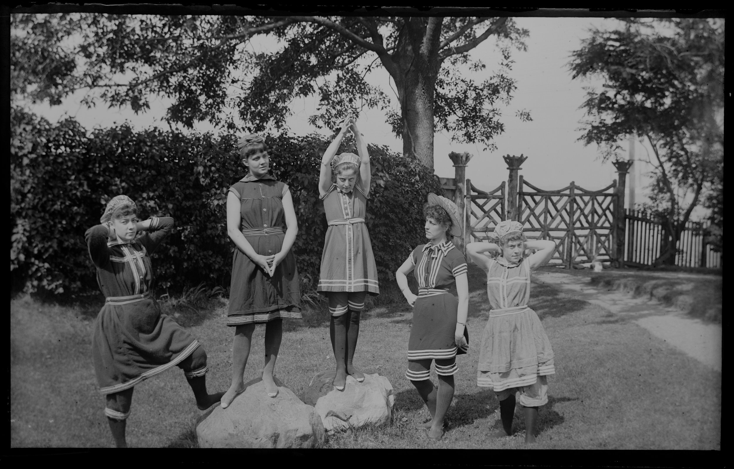 """Group in bathing costumes,"" on the lawn at Clear Comfort, September 17, 1885. Alice Austen stands at far left"