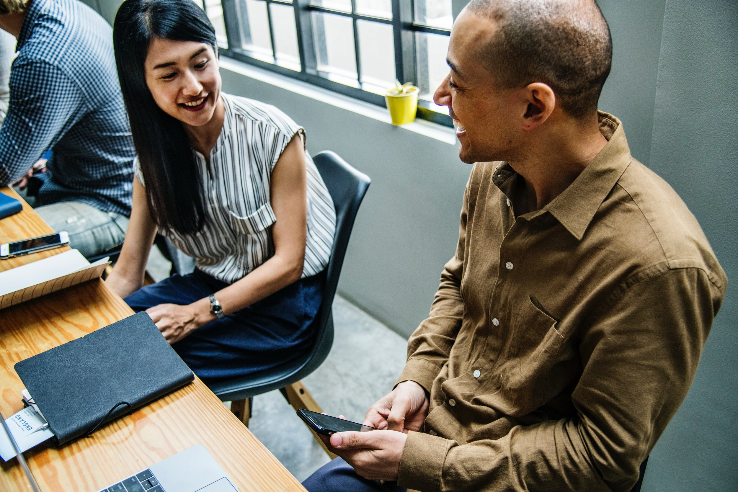 Image: Man and woman chatting at work. Photo: Photo by  rawpixel  on  Unsplash