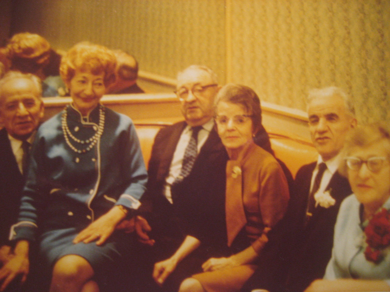1969. At Esther's wedding.   My great grandma is the lady in red. I have no idea who Esther is, but  things are all making sense now .