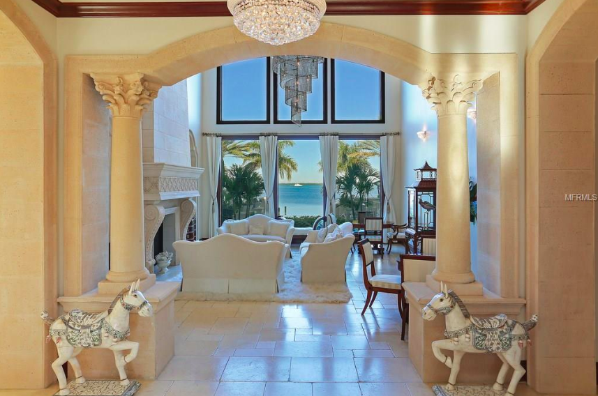 The grand entrance of this home features columns framing the picture-perfect seaside view.