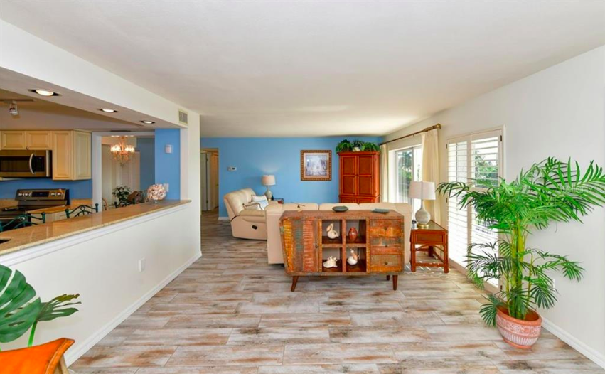 The entire living space has been updated and renovated with wood-look tile throughout.