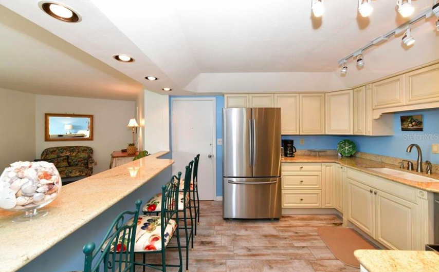 Kitchen and bathrooms have new granite and newer cabinetry. Kitchen features stainless appliances.