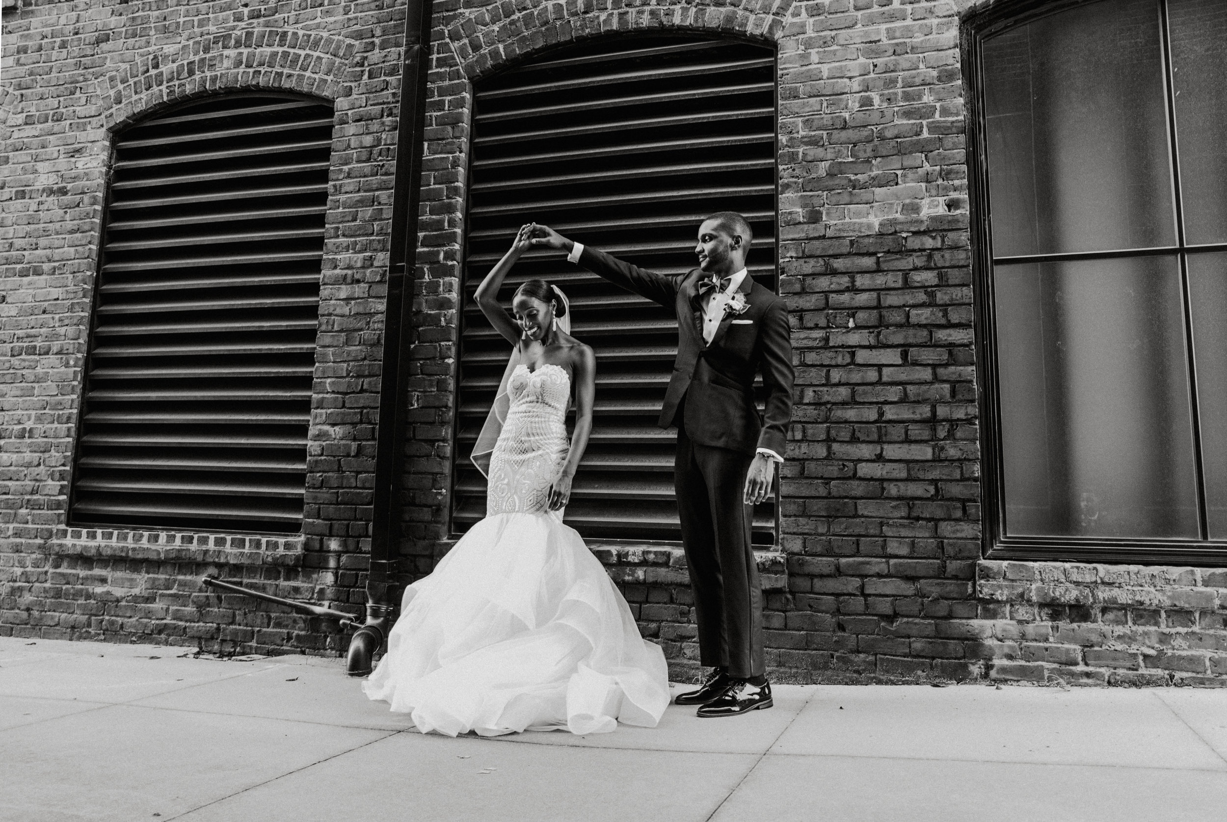 The Lofts at Union Square, High Point, NC. Wedding Photos, Wedding Portraits, Black and White Wedding Photo. North Carolina Wedding Photographer, Marina Rey Photography.