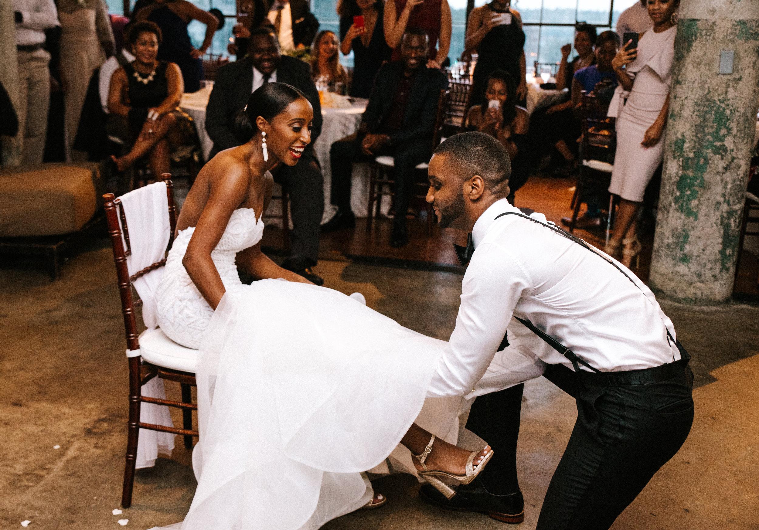The Lofts at Union Square, High Point, NC. Wedding Reception Photos, Garter Toss Photos. North Carolina Wedding Photographer, Marina Rey Photography.