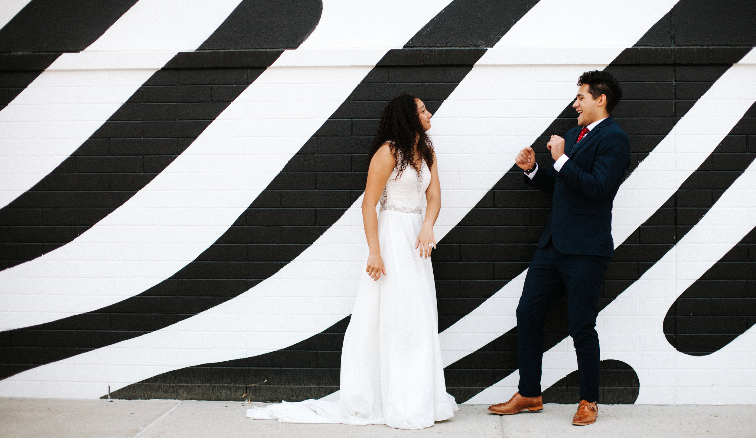 Black and white mural | Utah wedding photography, Salt Lake City Wedding Photos | Unique wedding photo | Candid dancing wedding photo | Bright, colorful wedding photography | Marina Rey Photography