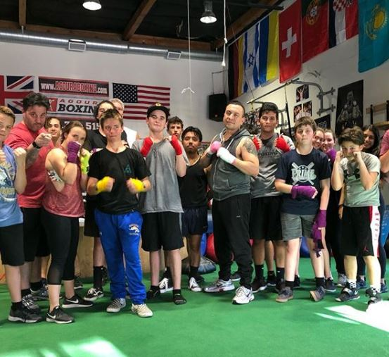 coach Henry and the beginners boxing class