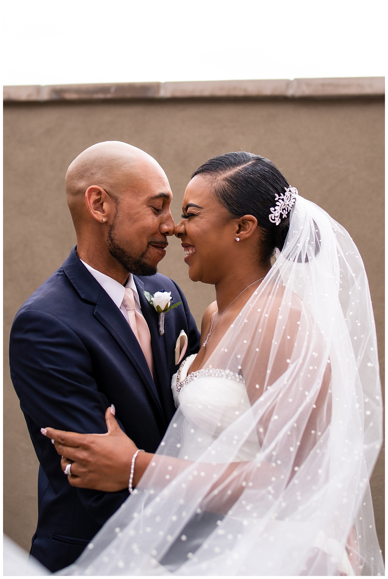 Seriously, obsessed with this veil, dress, everything, her entire look was poppin.