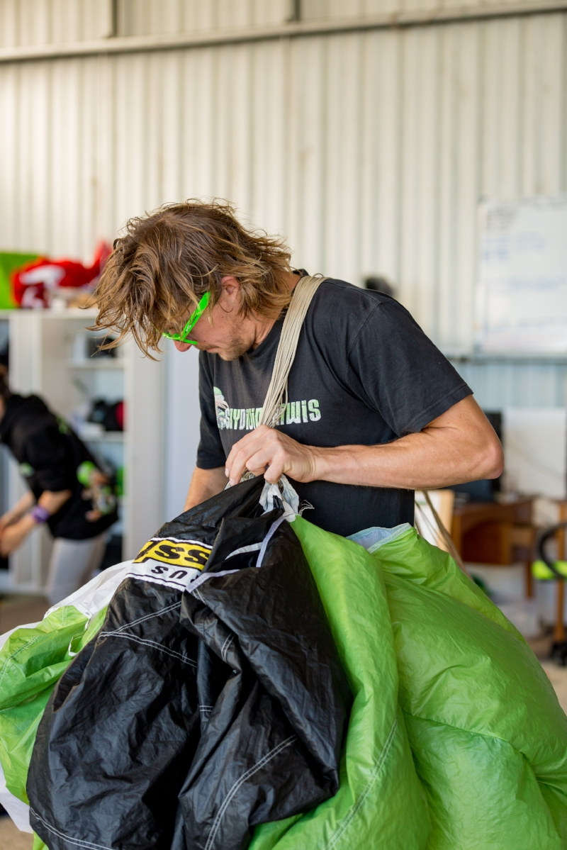 a team of parachute packers will work tirelessly throughout the day