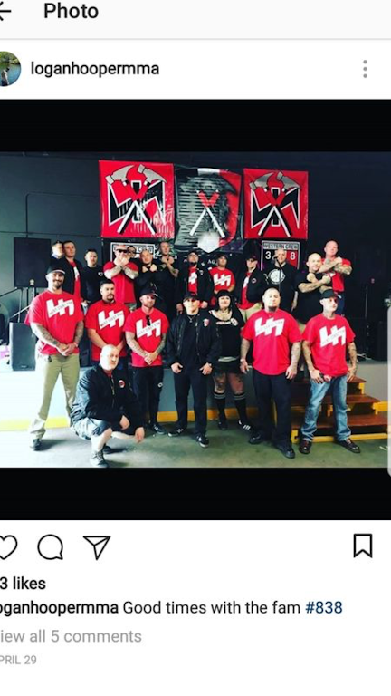 Photo caption: Tac Town Tattoo owner Jason De Simas is second from right in the front row. Tac Town piercer Irma Karr is third from right in the same row.