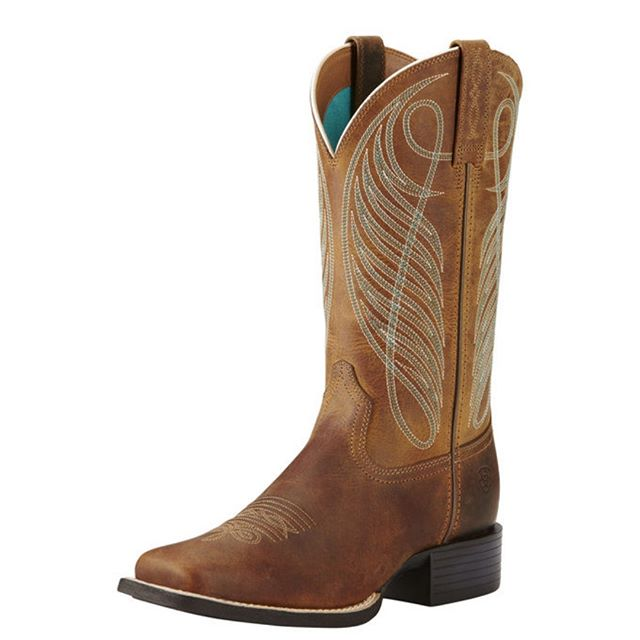 "Round Up Wide Square Toe Western Boot $219.95  Versatile country style ideal for the woman who prefers a little more toe room. •Full-leather foot and upper •Synthetic air-mesh lining •Duratread™ outsole •4LR™ footbed support and cushioning •Four-row stitch pattern •11"" shaft; 1.375"" heel  Don't forget about our rewards program! For every $50 (before tax, on regular priced items) you spend you will receive a stamp. After 10 we reward you with a $50 rewards certificate!"