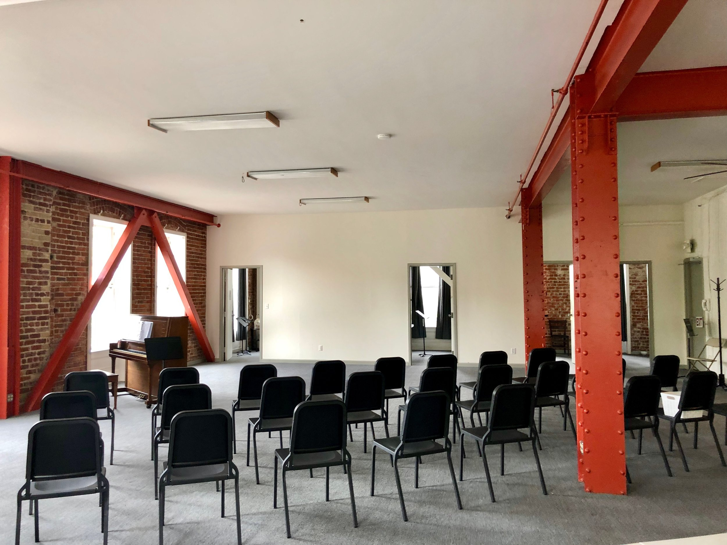Main Room w/ seating for up to 100 Uses: Rehearsal, performance, workshop, meeting, reception, yoga, dance