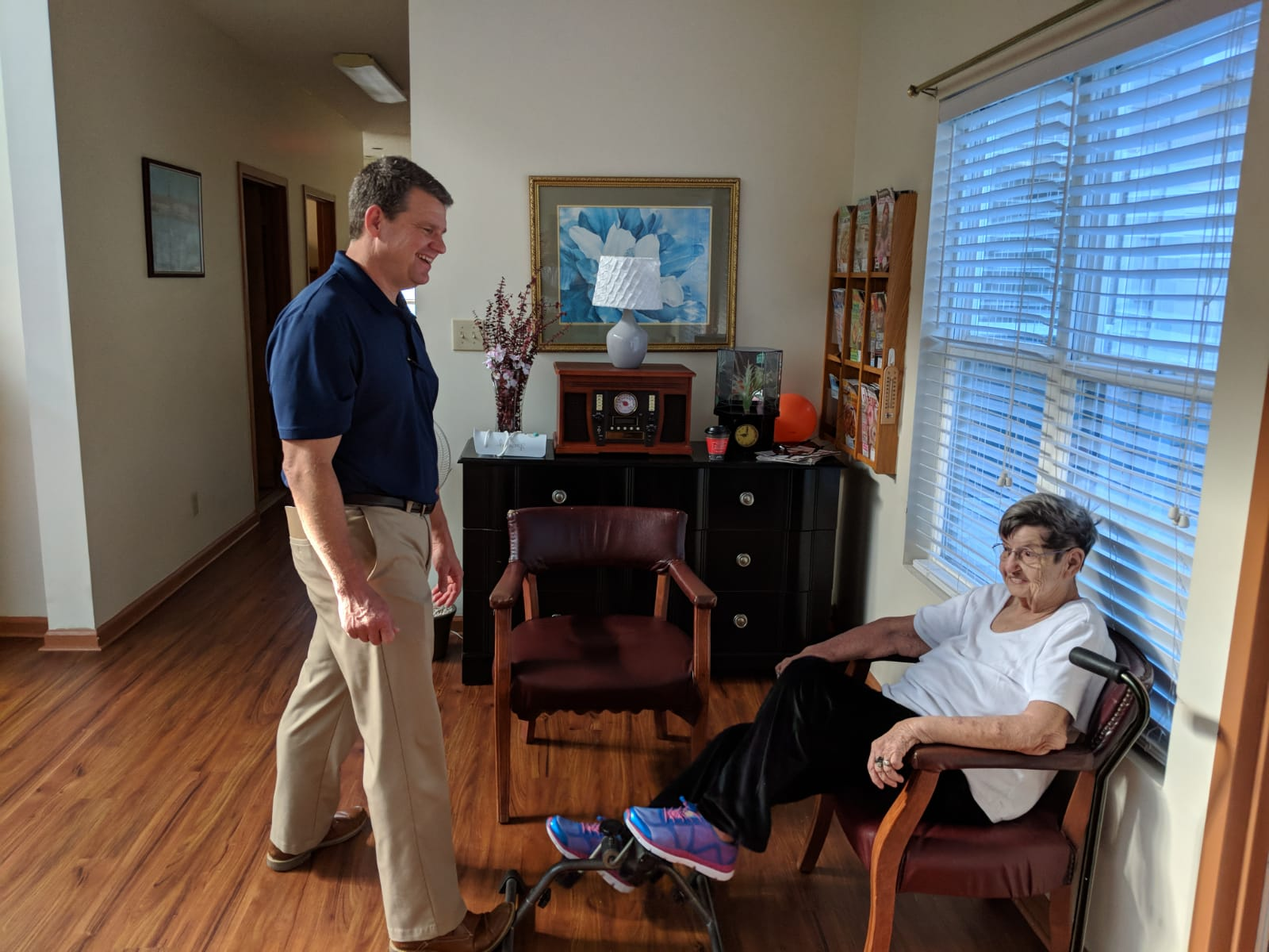 Physical therapist working with a resident.