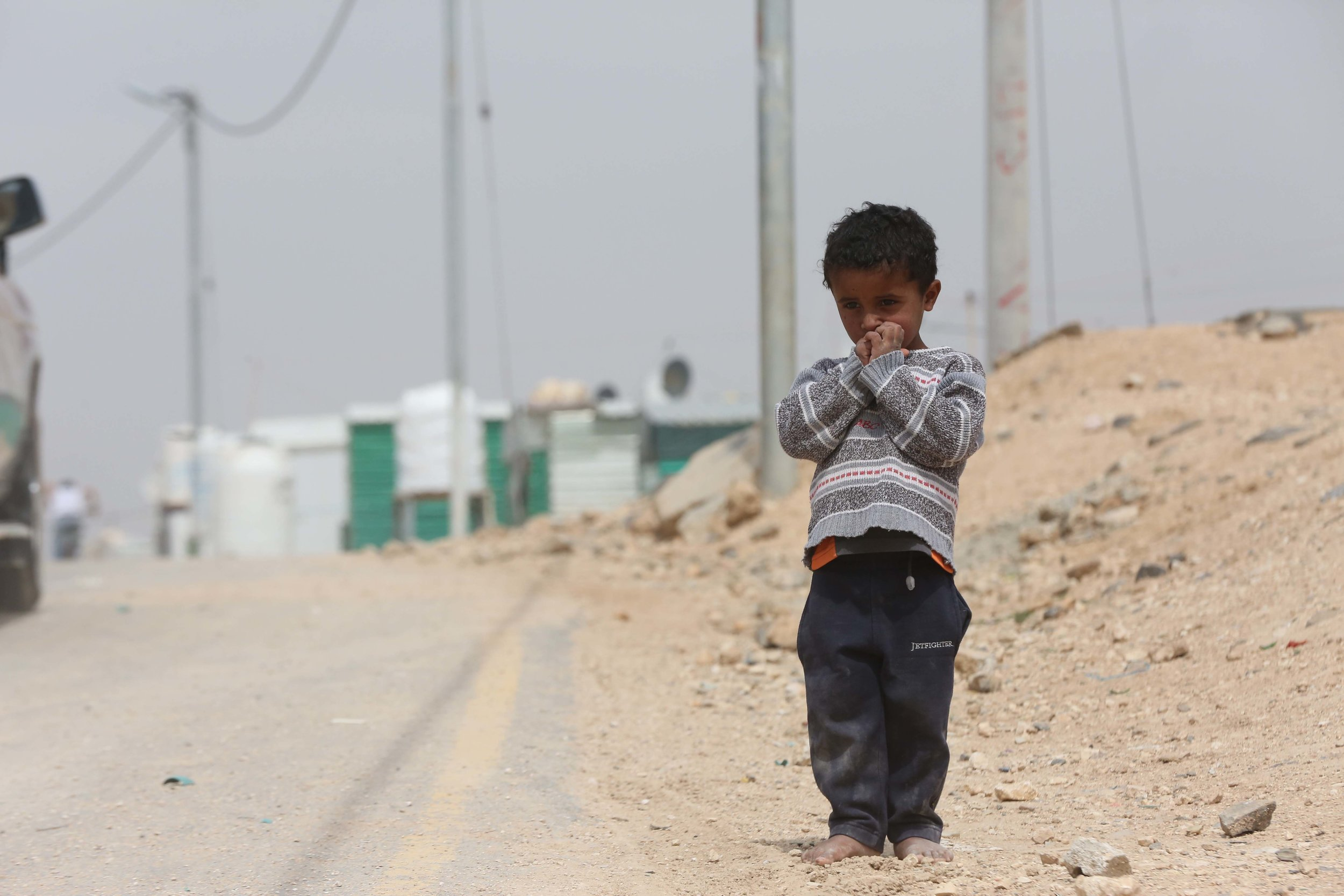 A young boy at the Zaatari Refugee Camp in Jordan, where nearly 80,000 Syrian refugees are living. 27 March 2017 I Zaatari Camp, Jordan  © UN Photo/Sahem Rababah