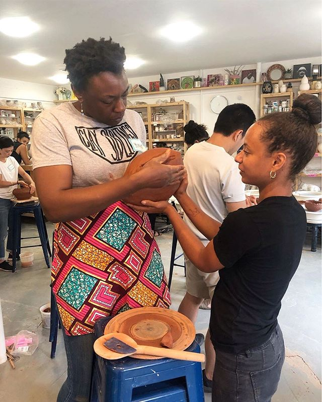 Thanks for the ❤️❤️❤️, @pot_la !!! Isn't it beautiful what we can achieve when working together in community? 🤗 Looking forward to many more collaborations in the future! . . 📸: Me helping to reinforce bottom of vessel while simultaneously representin' & rockin' my @claysiblings t-shirt. 🖤 . . #peopleofcolorpeopleofclay #pocartists #phillyartist #blackwomenartists #blackpotter #poctery #traditionalpottery #coilbuilt #womenpotters #sociallyengagedcraft #handmadepottery #collaborativeart #craftingcommunity . . . #Repost from @pot_la (@repost_media_app) Still reeling over the @crafting.community workshops we held this last weekend, the most fun workshops we've had to date IMO. What a truly inspiring and unique experience to make pottery communally, my whole perspective on pottery making has been rocked. There was no artists ego, no notion of this is my piece this is yours, and the space was void of competition amongst creators. Every pot had many hands in it, every pot had many different humans energies in it, and this process made helping each other to build much more welcoming. . Thank you so much Yinka for spreading your message of @crafting.community. We're blessed to have had you and I'm so inspired by you. Undoubtedly POT will be carrying forward the ethos you brought here. If you missed these sold out workshops don't worry this will def not be the last time we have Yinka here 💕🔥
