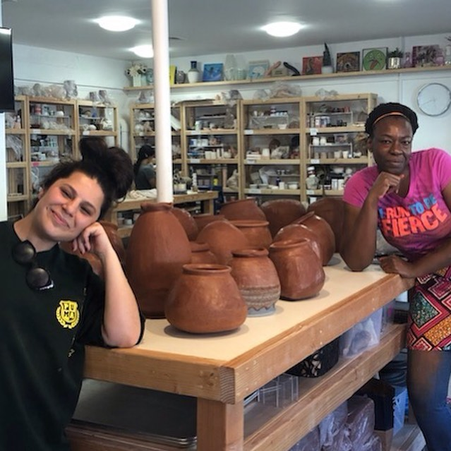 "The LA-edition of my ""Crafting Community"" initiative = 2 days + 4 workshops + 200 lbs of clay + 28 sets of hands to produce this beautiful collection of pots to be auctioned off in support of the @pot_la community-focused mission to make ceramics accessible for all!!!!!!! 💪🏿💪🏾💪🏽💪🏼💪🏻 . 📸: Me and @pot_la owner Mandy posing mad casual-like with the communal pottery from the workshops (photo credit: @333manda333 🙏🏿) . . . #peopleofcolorpeopleofclay #craftingcommunity #traditionalpottery #handmadeceramics #phillyartist #claylife #blackpotter #blackwomenartists #coilbuilt #communitymade #handmadepottery #womenpotters"