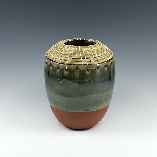 Small vase with green pine needles