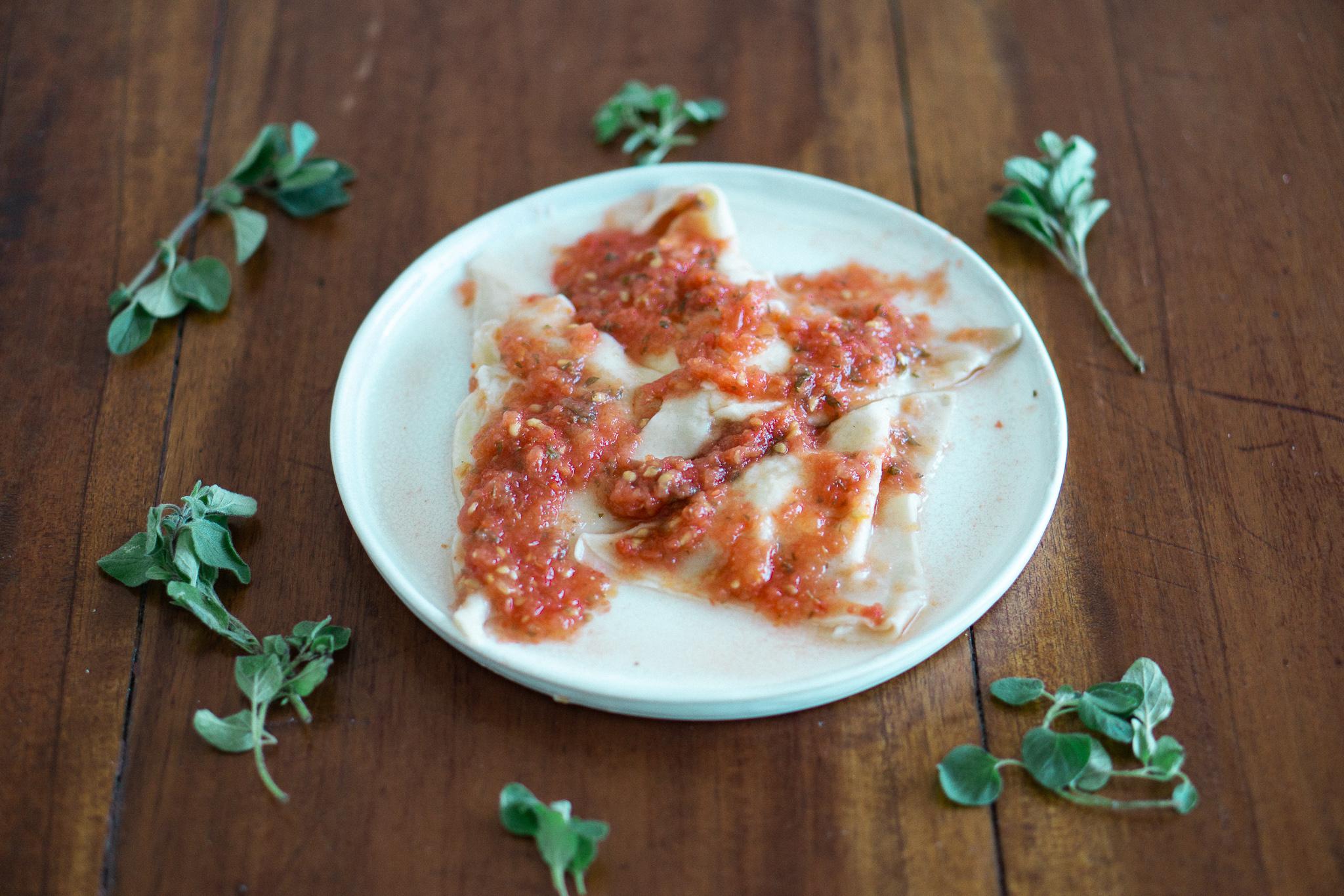 Cacio e Pepe Ravioli with Fresh Tomato Sauce